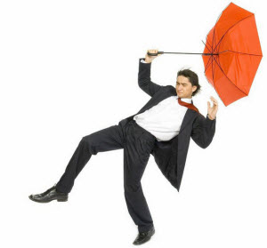 Man being blown away by a strong wind from a storm.