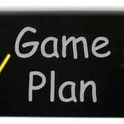 Game plan written on a black board.