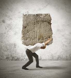 Man carrying a boulder.