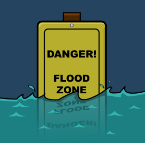 Danger flood zone signage slowly getting sink in the water caused by the flood.