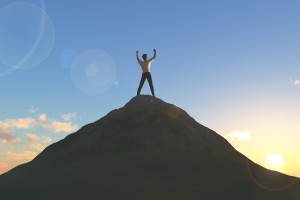 Topless man on top of a mountain on a bright morning sunshine.bright