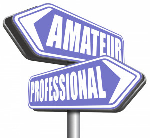Street sign pole showing amateur and professional.