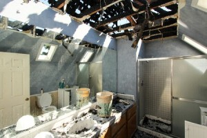 Damaged ceilings in the bathroom caused by the fire.